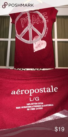 Aeropostale L capsleeved tee excellent condition, worn once, red w/ white & gray peace graphics Aeropostale Tops Tees - Short Sleeve