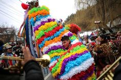 A man performs the goat's dance in the town of Comanesti, Romania, December 30, 2016.
