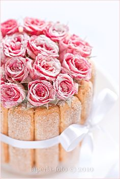 Cake decoraed with candied whole rose heads and ladyfingers... very different... like this a lot...