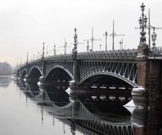 Trinity Bridge, St. Petersburg-built between 1897-1903, Trinity Bridge embodies the graceful elegance of a steel, granite and cast-iron design. French President Félix Faure, along with Nicholas II, poised its first stone on August 24th, 1897. With its ornate tri-globed lamps, the bridge reflects the aesthetics of the time and bears remarkable resemblance, both physically and conceptually, to another bridge completed in Paris at the end of the nineteenth century. Namely, the Alexander III…