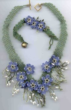 ALPINE FORGET- ME- NOT  This is a two day workshop for intermediate to advanced students    Margo designed this special project for the 2005 Creative Castle.  The Alpine Forget-Me-Not is the Alaskan State Flower.  Learn to make these little beauties using size 15` seed beads.  Necklace and bracelets are made from size 11` seed beads using a diagonal netting technique.Twin Thistles