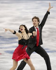 Nathalie Pechalat and Fabian Bourzat of France compete in the ice dance short dance figure skating competition at the Iceberg Skating Palace...