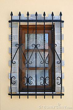 Window with iron security bars by Vladimir Krnetic
