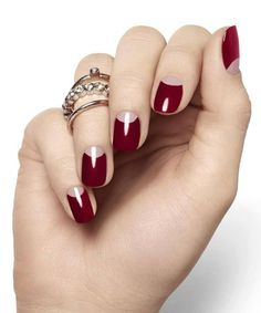 This reverse French manicure in red & pink is the perfect choice for Valentine's Day! This look uses a dark ruby red w/ light pink, but the options are limitless.