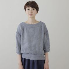 Make something like this: round yoke, raglan sleeves, band at bottom with mother of pearl buttons on one side