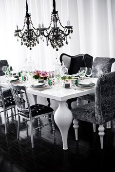 Hollywood glamour mixed with a little bit of Gothic plus essence of Georgian style results in a quirky Dining Room that is mad but marvellous! Black and white schemes are always dramatic, one chandelier is luxurious, two are outrageously luxurious (!) and the mis-matched chairs add a great dollop of wit.