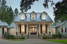 Palmetto Bluff home: Pearce Scott Architects  This is one of our favorite homes at PSA. We love this southern style coastal cottage. What an inviting facade with beautiful windows and shutters open porch and tin roof!