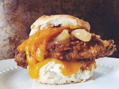 Perfect for any meal, this delicious Southern fried pork chop biscuit sandwich recipe is loaded with sharp cheddar cheese and sweet spiced apples.