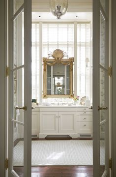 Bathroom with vanity mirror hung over windows for perfect natural light.
