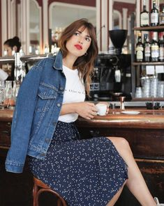 Floral midi skirt, white tee, denim jacket, red lip.   7 French-Girl Inspired Outfits to Shop at Kmart via @WhoWhatWearAU