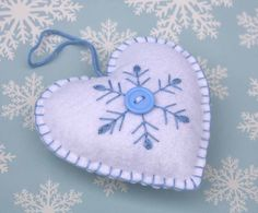 Felt Christmas Ornament, Scandinavian Heart ornament, Felt heart decoration,Embroidered Snowflake heart, Holiday decor, Handmade felt heart by PuffinPatchwork on Etsy https://www.etsy.com/listing/116049286/felt-christmas-ornament-scandinavian