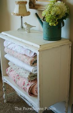 Nightstand with drawers removed - great idea for storing bulky items such as quilts