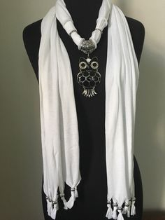 A personal favorite from my Etsy shop https://www.etsy.com/listing/512522275/white-energy-wrap-with-owl-scarf-jewelry
