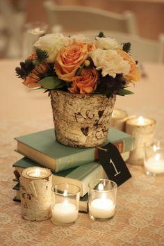 Stacked books plus the wooden flower arrangement - such a pretty centerpiece #wedding #centerpiece #weddingdecor #tablescape #woodland