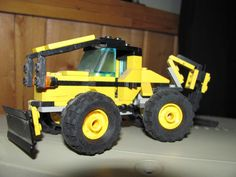 This skidder comes with a backhoe and a plow on the front. If it looks real, that's because the person who built the skidder even added a bit of dirt to make it look more authentic.