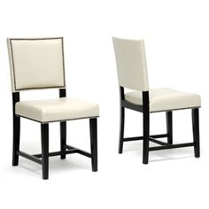 @Overstock.com - These fashionable dining chairs add a modern look to any dining area. The set of two chairs features a black wood frame upholstered in cream faux leather. The chair backs are finished with an antiqued nail head trim for a unique appearance.http://www.overstock.com/Home-Garden/Nottingham-Cream-Faux-Leather-Modern-Dining-Chairs-Set-of-2/7183196/product.html?CID=214117 $184.99