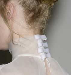 Delicate Details... sheer, high neck collar with a little row of bows - femininity; simplicity; fashion details