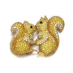Diamond and onyx brooch, Graff Designed as two squirrels, pavé-set with brilliant-cut diamonds of yellow and near-colourless tints, enhanced with polished onyx eyes and nose, signed Graff.