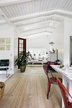 Swedish home.  I love the wood floors, white ceiling and walls, lots of windows, and rustic furniture. ah! perfection.