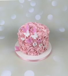 Pink Buttercream smash cake with butterflies
