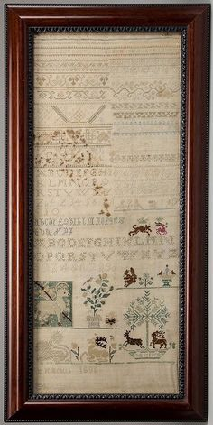 EUROPEAN SEVENTEENTH CENTURY NEEDLEWORK BAND SAMPLER, silk on linen, multiple rows of stitch samples above rows of ABCs and numerals, lower...