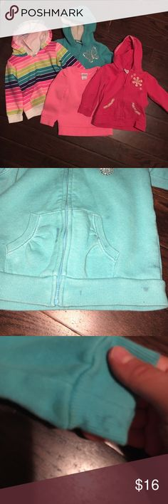 Bundle of sweatshirts 4 total.  The teal one and the pink one with a flower are Sonoma.  The solid pink is Circo, and the striped one is jumping beans.  No rips, but there are signs of wear.  The teal one has several stains on the front.  I haven't attempted to get them out, so not sure if they will come out.  Would like to sell together but will separate. Shirts & Tops Sweatshirts & Hoodies
