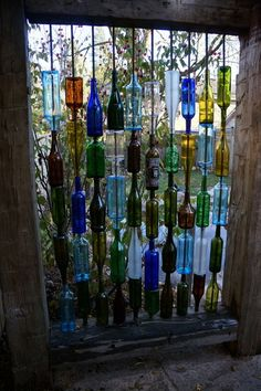 wine bottles were threaded onto pieces of rebar, making a unique and whimsical privacy screen.
