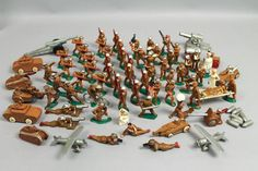 This is a wonderful large collection of lead hollowcast toy soldier figurines, guns, and vehicles. Dating to the 1930s and 1940s, this group features hand painted details.