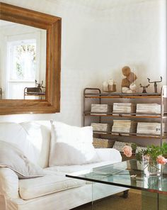 Industrial style: plate glass table, metal rack as bookshelf