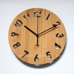 Modern number fonts with black clock hands shows time clearly.  Material: Bamboo  Color: Original (light) and Carbonize (dark )  Taiwan quartz movements: