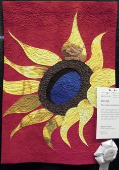 Piece-lique Sunflower by Alyce J. Leach, design by Sharon Schamber.  Photo by Quilt Inspiration
