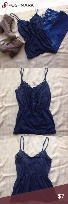 Aeropostale navy blue lace embellished cami This listing is for a pretty Aeropostale lace embellished top! It has buttons up the front and adjustable straps. It's cinched at the waist with elastic and has small belt loops, but no included belt. There has been a small repair done on the left underarm, shown in the last photo. Besides slight pilling, it is in great condition! Measurements: bust is just over 26 inches. Waist unstretched is 21 inches. Overall length is about 21 inches…