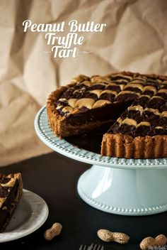Peanut Butter Truffle Tart...Ingredients: 1 16.5 oz Pillsbury® refrigerated peanut butter cookies, 6 peanut butter crunchy granola bars - crushed, 4 cups semisweet chocolate chips, 1 cup whipping cream, 1/2 cup crunchy peanut butter, 1/3 cup chopped peanuts...