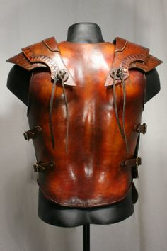 davidpowellart: Leo armor: Based on Roman and Greek styles of armor, this piece is made from 16 oz molded leather, with gold leaf details an...