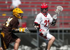 Boys' Lacrosse. Great action shot of focusing on players and blurring out the background.