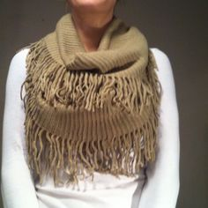 ✨NEW LIST✨Double Fringe Double Wrap Scarf Gorgeous, cozy and comfy 100% acrylic scarf. NWT on bag the item comes in not on scarf itself. Beautiful Beige color, well suited for any color coat or top. aerspamer's  Accessories Scarves & Wraps