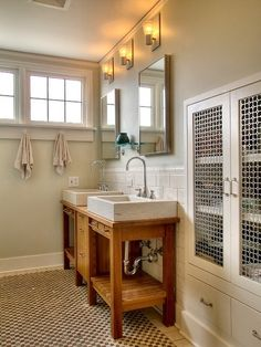 Add an architectural feature. Grilles are composed either of a woven wire mesh or perforated metal sheets. A large-scale pattern adds architectural interest. In a bathroom it can conceal a jumble of toiletries while making the space feel more open.
