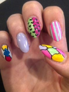 Simple Colorful Nail Art Ideas 2012 - Get a head-to-toe makeover for next year and complete your manicure collection with a few fabulous designs. These simple colorful nail art ideas 2012 will provide you with a selection of patterns and prints you can experiment with.