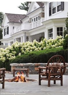 Backyard Haven: stone bench, firepit, white house + black shutters, and lot