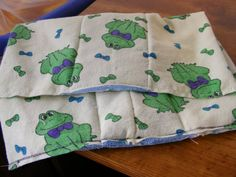Pre-fold cloth diaper inserts with microfiber and unused receiving blankets.