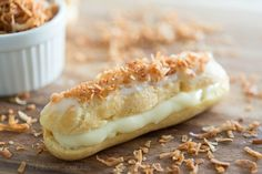 Coconut rum eclairs, Classic choux pastry is filled with a luscious coconut rum filling and topped with toasted coconut, for a unique eclair dessert! Profiteroles, Eclairs, Pastry Recipes, Gourmet Recipes, Sweet Recipes, Dessert Recipes, Cooking Recipes, Rum Recipes, Cocktail Recipes
