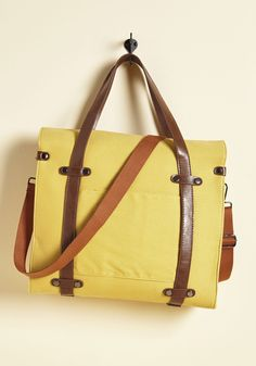 Camp Director Tote in Camel. When the cabins shutter up for the season, take a bit of camp charm with you by packing your essentials in this rustically refined tote! #yellow #modcloth