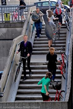Staircase fitted with a generous bike rail at Copenhagen Central Train Station. Click image to enlarge & & visit this board http://www.pinterest.com/slowottawa/streets-for-everyone/ for more smart solutions.