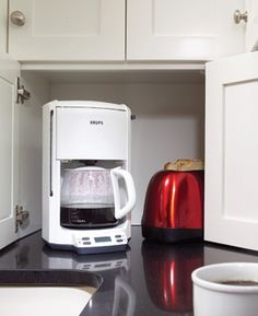 Appliance Garage -A corner appliance cabinet hides coffeemakers, toasters and other small appliances while making efficient use of often-wasted corner space.