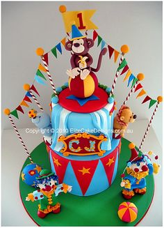 Our circus - carnival birthday cake design!  This very colourful design  features fully hand sugarcrafted decorations, animal and clown figurines, that may be kept forever!