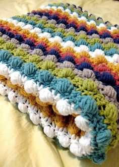 Bobble Stitch Blanket ~ a real nice, large 'bumpy' stitch pattern.  It has a solid feeling to it and very versatile.  Love the colors too.  Within the site, there's a couple of sites to go to, from it's origin.  NICE pattern!