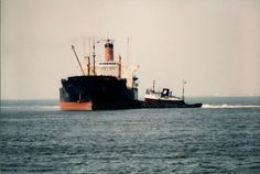 """Brown Marine provided a harbor tug to the Port of Pensacola for many years. This is the harbor tug """"Janet"""" while assisting a ship at the Port of Pensacola."""