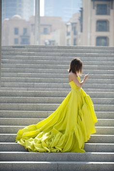neon colors fashion trend inspiration street style yellow gown stairs