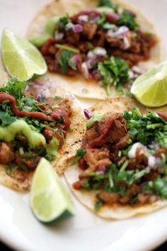 Tacos al Pastor made with rotisserie-cooked pork, pineapple, red onion, cilantro, guacamole, and Mexican-spiced sauce from Anna's Taqueria