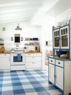 I like how the different colors make a plaid look Vinyl Kitchen Floor Tiles - American Home Decor - Woman's Day